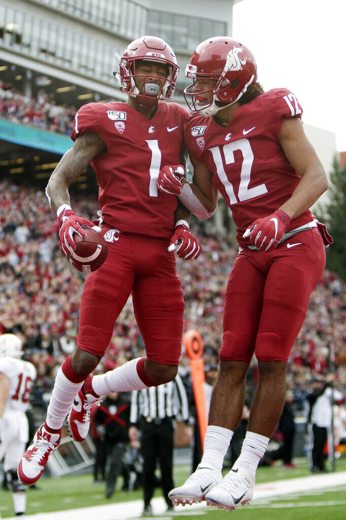 Washington State wide receiver Davontavean Martin (1) celebrates his touchdown with wide receiver Dezmon Patmon (12) during the first half of an NCAA college football game against Stanford in Pullman, Wash., Saturday, Nov. 16, 2019. (AP Photo/Young Kwak)