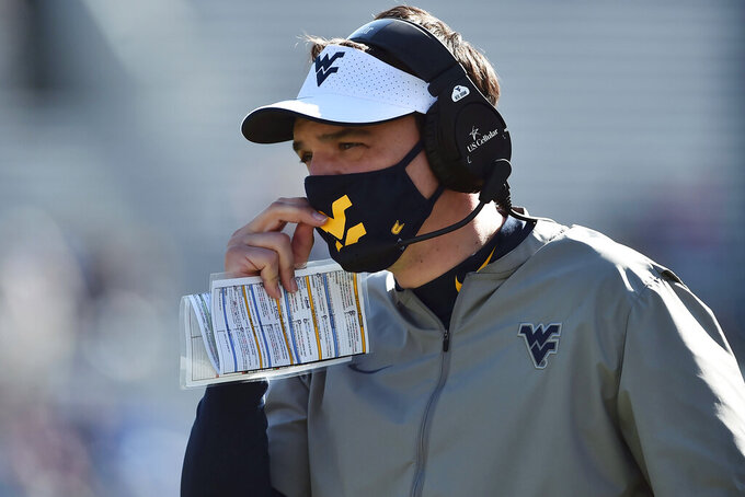 West Virginia head coach Neal Brown looks on during an NCAA college football game against Kansas, Saturday, Oct. 17, 2020, in Morgantown, W.Va. (William Wotring/The Dominion-Post via AP)