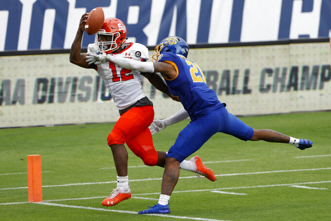 Sam Houston State wide receiver Jequez Ezzard (12) has a pass broken up by South Dakota State cornerback Don Gardner (21) during the second half of the NCAA college FCS Football Championship in Frisco, Texas, Sunday, May 16, 2021. (AP Photo/Michael Ainsworth)