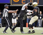 Vanderbilt head coach Derek Mason, center, pushes defensive lineman Dayo Odeyingbo (10) off the field during a confrontation between Vanderbilt and Florida in the first half of an NCAA college football game Saturday, Oct. 13, 2018, in Nashville, Tenn. (AP Photo/Mark Humphrey)