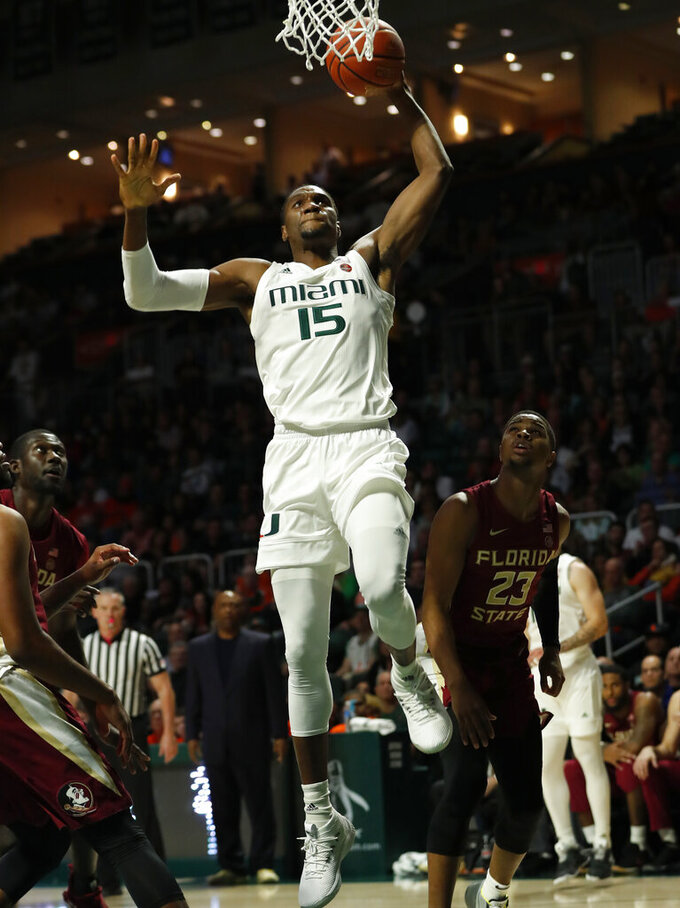 FILE - In this Jan. 27, 2019, file photo, Miami center Ebuka Izundu (15) dunks the ball during the first half of an NCAA college basketball game against Florida State, in Coral Gables, Fla. The mother of Miami Hurricanes senior center Ebuka Izundu is flying from her home in Nigeria to see him play a college game for the first time. Emma Izundu will attend Tuesday's, March 5, 2019,  game against Pittsburgh, the final home game of her son's four-year Miami career.(AP Photo/Wilfredo Lee, File)