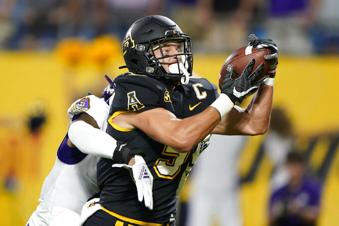 Appalachian State wide receiver Thomas Hennigan catches a touchdown pass in front of East Carolina cornerback Malik Fleming during the first half of an NCAA college football game Thursday, Sept. 2, 2021, in Charlotte, N.C. (AP Photo/Chris Carlson)