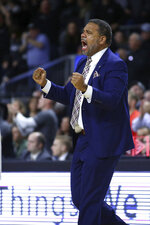 Providence head coach Ed Cooley celebrates a three-pointer during the first half of an NCAA college basketball game against Marquette Saturday, Feb. 22, 2020, in Providence, R.I. (AP Photo/Stew Milne)