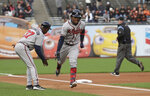 Atlanta Braves' Ronald Acuna Jr., front right, is congratulated by third base coach Ron Washington (37) after hitting a solo home run against the San Francisco Giants during the first inning of a baseball game in San Francisco, Monday, May 20, 2019. (AP Photo/Jeff Chiu)
