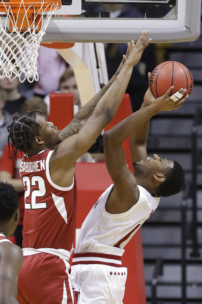 Indiana's Aljami Durham (1) puts up a shot against Arkansas's Gabe Osabuohien (22) during the first half in the second round of the NIT college basketball tournament, Saturday, March 23, 2019, in Bloomington, Ind. (AP Photo/Darron Cummings)