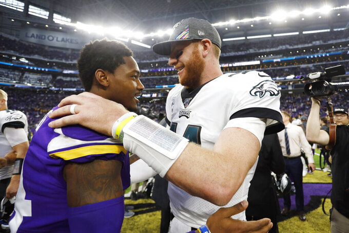 Minnesota Vikings wide receiver Stefon Diggs, left, talks with Philadelphia Eagles quarterback Carson Wentz after an NFL football game, Sunday, Oct. 13, 2019, in Minneapolis. (AP Photo/Bruce Kluckhohn)