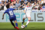Lyon's Eugenie Le Sommer, right, challenges for the ball with Chelsea's So-Yun Ji, left, during their Women's Champions League semifinal soccer match in Decines, France, Sunday, April 21, 2019. (AP Photo/Laurent Cipriani)