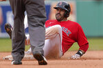 Boston Red Sox's J.D. Martinez is safe at second base after hitting a double off a pitch by Seattle Mariners' Ljay Newsome in the seventh inning of a baseball game, Sunday, April 25, 2021, in Boston. (AP Photo/Steven Senne)