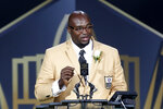 "FILE - In this Aug. 8, 2015, file photo, former NFL player Will Shields delivers his speech during an induction ceremony at the Pro Football Hall of Fame in Canton, Ohio. While 14 NFL franchises are using their stadiums in the voting process, former players such as Hall of Famer Will Shields are going into communities to help with registrations and mail-in ballots. Shields, who received the league's Walter Payton Man of the Year award in 2003 and was a member of the 2000s All-Decade Team, recognizes the importance of ""doing your part.""(AP Photo/Tom Puskar, File)"