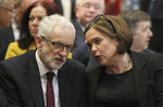 Labour Party leader Jeremy Corbyn and Sinn Fein leader Mary Lou McDonald talk, prior to the start of the funeral service of slain journalist Lyra McKee at St Anne's Cathedral in Belfast, Northern Ireland, Wednesday April 24, 2019.  The leaders of Britain and Ireland will join hundreds of mourners Wednesday at the funeral of Lyra McKee, the young journalist shot dead during rioting in Northern Ireland last week. (Brian Lawless/Pool Photo via AP