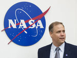 Administrator of the National Aeronautics and Space Administration (NASA) Jim Bridenstine enters the hall before a news conference at the U.S. embassy in Moscow in Moscow, Russia, Friday, Oct. 12, 2018. (AP Photo/Pavel Golovkin)