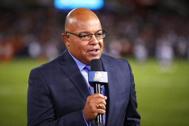 "FILE - In this Sept. 5, 2019, file photo, NBC sportscaster Mike Tirico works the sidelines during an NFL football game between the Green Bay Packers and the Chicago Bears in Chicago. Tirico is returning to do a daily talk show, focusing on the coronavirus pandemic's impact on the sports world. ""Lunch Talk Live"" will air weekdays for an hour, beginning at noon EDT on NBCSN. Tirico will host the show remotely from his home in Michigan. (AP Photo/Jeff Haynes, File)"