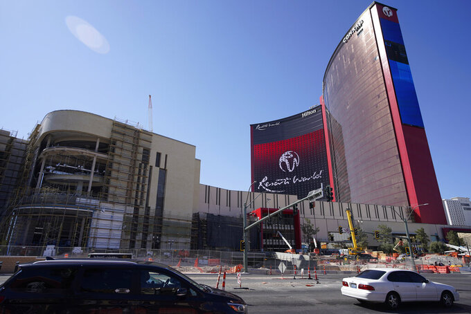 Construction continues on Resorts World Las Vegas, Monday, April 19, 2021, in Las Vegas. The hotel-casino announced Monday that it will open June 24. (AP Photo/John Locher)