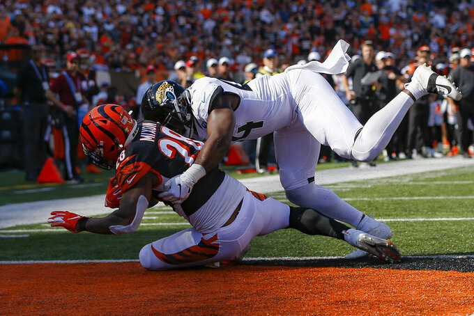 Cincinnati Bengals running back Joe Mixon (28) scores a touchdown against Jacksonville Jaguars middle linebacker Myles Jack (44) in the first half of an NFL football game, Sunday, Oct. 20, 2019, in Cincinnati. (AP Photo/Frank Victores)