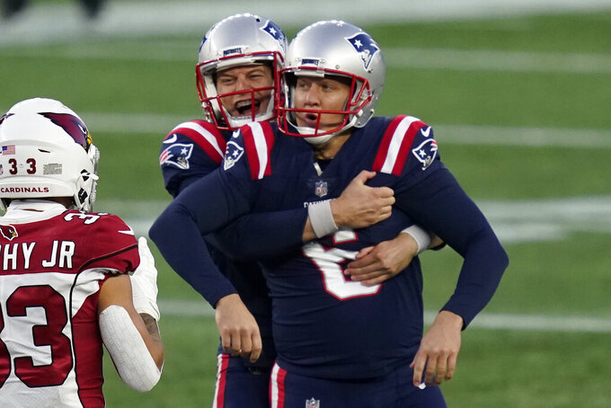 New England Patriots kicker Nick Folk celebrates his game-winning field goal with holder Jake Bailey, rear, as time expires in an NFL football game against the Arizona Cardinals, Sunday, Nov. 29, 2020, in Foxborough, Mass. (AP Photo/Elise Amendola)
