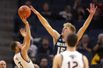 Nevada forward Zane Meeks (15) harasses Saint Mary's guard Jordan Ford (3) as he shoots during the first half of an NCAA college basketball game on Saturday, Dec. 21, 2019, in San Francisco. (AP Photo/D. Ross Cameron)