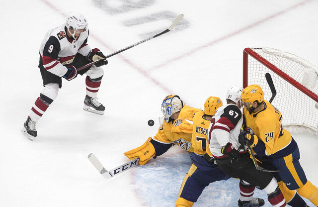 Arizona Coyotes' Clayton Keller (9) is stopped by Nashville Predators' goalie Juuse Saros (74)  during the first period of NHL qualifying round game action in Edmonton, on Tuesday, Aug. 4, 2020.  (Jason Franson/The Canadian Press via AP)