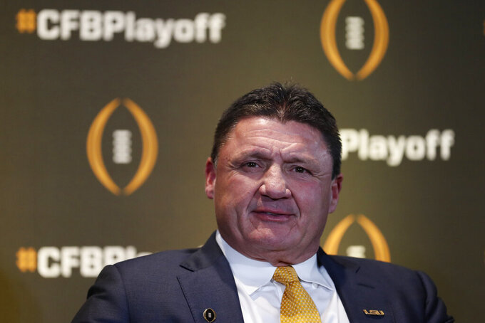 LSU head coach Ed Orgeron speaks during a news conference ahead for the College Football playoffs Thursday, Dec. 12, 2019, in Atlanta. Ryan Day of Ohio State was unable to attend. (AP Photo/John Bazemore)