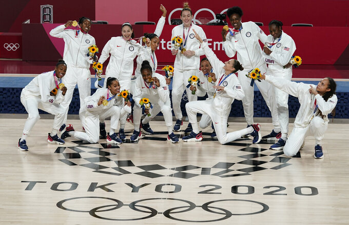 United States players pose with their gold medals during the medal ceremony for women's basketball at the 2020 Summer Olympics, Sunday, Aug. 8, 2021, in Saitama, Japan. (AP Photo/Charlie Neibergall)