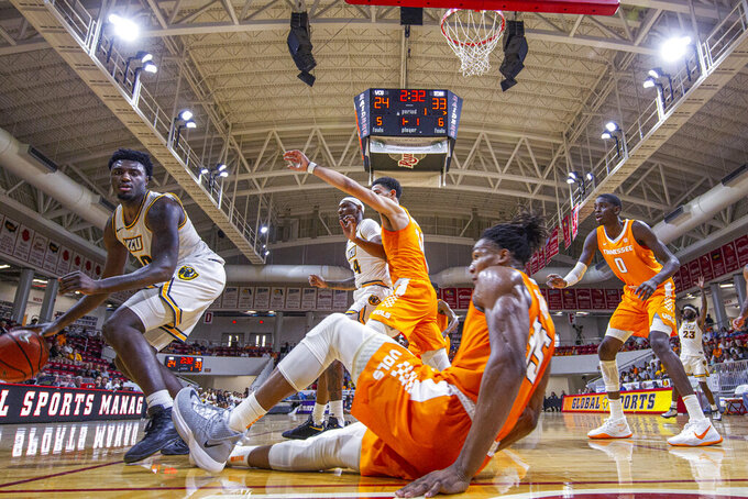Tennessee guard Yves Pons (35) hits the floor as Virginia Commonwealth guard Vince Williams (10) works his way closer to the basket in the first half of an NCAA college basketball game at the Emerald Coast Classic in Niceville, Fla., Saturday, Nov. 30, 2019. (AP Photo/Mark Wallheiser)