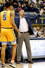 Pittsburgh head coach Jeff Capel, right, questions a call during the first half of an NCAA college basketball game against Notre Dame, Saturday, March 9, 2019, in Pittsburgh. Pittsburgh won 56-53.(AP Photo/Keith Srakocic)