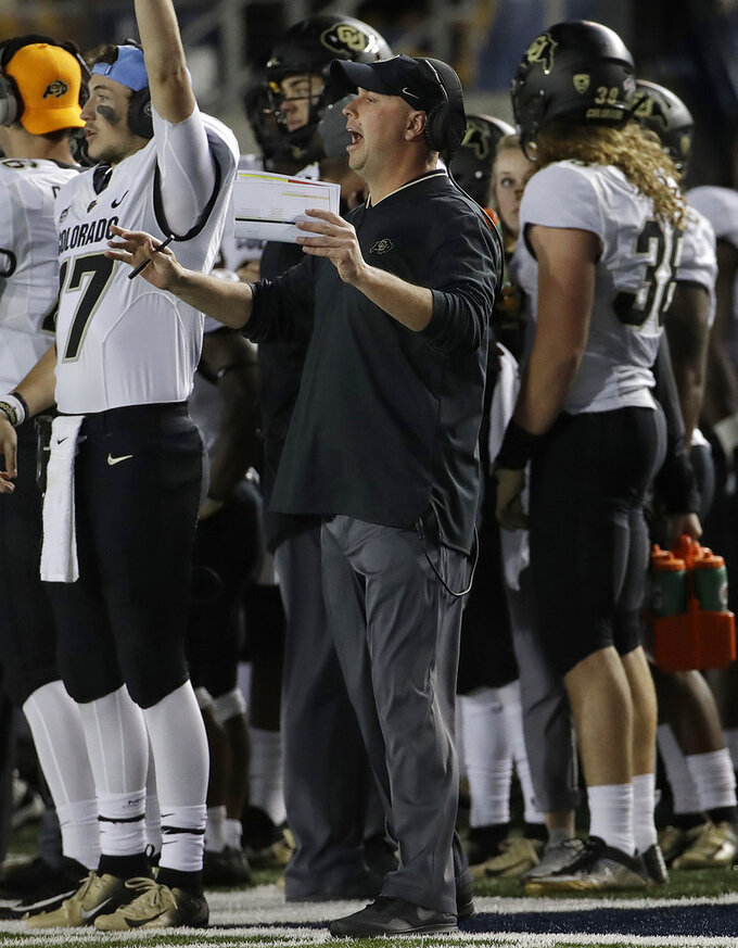 Colorado interim head coach Kurt Roper gestures during the first half of his team's NCAA college football game against California in Berkeley, Calif., Saturday, Nov. 24, 2018. (AP Photo/Jeff Chiu)