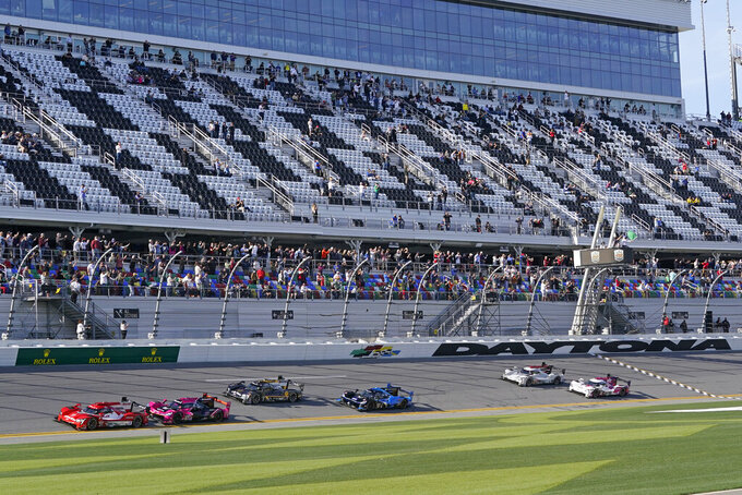 Felipe Nasr, far left, of Brazil, leads the field to start of the Rolex 24 hour auto race at Daytona International Speedway, Saturday, Jan. 30, 2021, in Daytona Beach, Fla. (AP Photo/John Raoux)