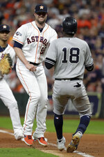 Houston Astros relief pitcher Ryan Pressly, left, tags out New York Yankees' Didi Gregorius during the third inning in Game 6 of baseball's American League Championship Series Saturday, Oct. 19, 2019, in Houston. (AP Photo/Eric Gay)