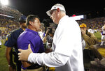 LSU head coach Ed Orgeron, left, is congratulated by Mississippi State head coach Joe Moorhead after an NCAA college football game in Baton Rouge, La., Saturday, Oct. 20, 2018. LSU won 19-3. (AP Photo/Tyler Kaufman)