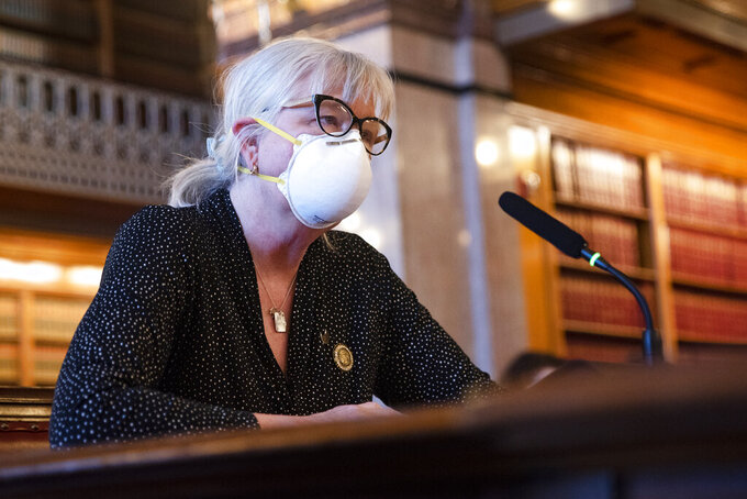 Rep. Beth Wessel-Kroeschell (D, D-45) speaks on Tuesday, Jan. 19, 2021, in opposition to HSB 9, a legislation proposing an amendment to the Iowa Constitution that upholds the right to keep and bear arms at the Iowa State Capitol, in Des Moines. (Olivia Sun/The Des Moines Register via AP)