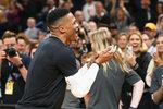 Houston Rockets guard Russell Westbrook greets Oklahoma City Thunder fans before an NBA basketball game Thursday, Jan. 9, 2020, in Oklahoma City. (AP Photo/Sue Ogrocki)