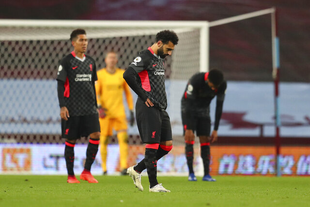 Liverpool's Mohamed Salah, gestures after Aston Villa's Ross Barkley scores his side's fifth goal during the English Premier League soccer match between Aston Villa and Liverpool at the Villa Park stadium in Birmingham, England, Sunday, Oct. 4, 2020. (Peter Powell/Pool via AP)