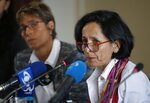 Luz Marina Monzon, left, director of the missing person's unit, speaks during a presentation on information on those disappeared during the nation's civil conflict, in Bogota, Colombia, Tuesday, Aug. 20, 2019. A special unit tasked by Colombia's peace process to search for the thousands who disappeared over more than five decades of conflict will analyze the information and work with authorities to try and locate remains. (AP Photo/Fernando Vergara)