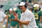 South Florida head coach Jeff Scott tries to fire up his team against Florida during the first half of an NCAA college football game Saturday, Sept. 11, 2021, in Tampa, Fla. (AP Photo/Chris O'Meara)