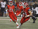 Fresno State Juju Hughes runs back an intercepted pass against Hawaii during the second half of an NCAA college football game in Fresno, Calif., Saturday, Oct. 27, 2018. Fresno State won 50-20. (AP Photo/Gary Kazanjian)