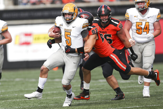 Oregon State outside linebacker Cory Stover (82) takes down Idaho quarterback Mike Beaudry (5) during the first half of an NCAA college football game Saturday, Sept. 18, 2021, in Corvallis, Ore. (AP Photo/Amanda Loman)