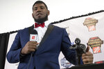 FILE - In this Dec. 7, 2017, file photo, Houston defensive tackle Ed Oliver, winner of the Outland Trophy for outstanding interior lineman, stands with the trophy while taking questions during the College Football Awards show at the College Football Hall of Fame, in Atlanta. Oliver has already announced he will enter the NFL draft after his junior season. He has a chance to be the top pick next April, but for now he is focused on getting the Cougars an AAC title. (AP Photo/John Amis, File)