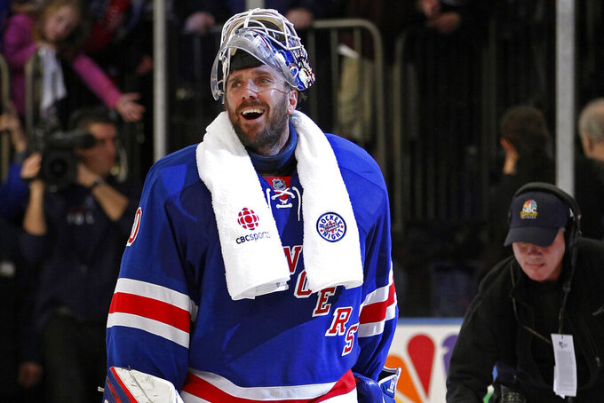 FILE - In this May 12, 2012, file photo, New York Rangers goalie Henrik Lundqvist (30) reacts after the Rangers defeated the Washington Capitals in Game 7 of a second-round NHL hockey Stanley Cup playoff series at Madison Square Garden in New York. Lundqvist, one of the greatest goaltenders of his generation, announced his retirement Friday, Aug. 20, 2021, less than nine months after heart surgery. (AP Photo/Kathy Willens, File)