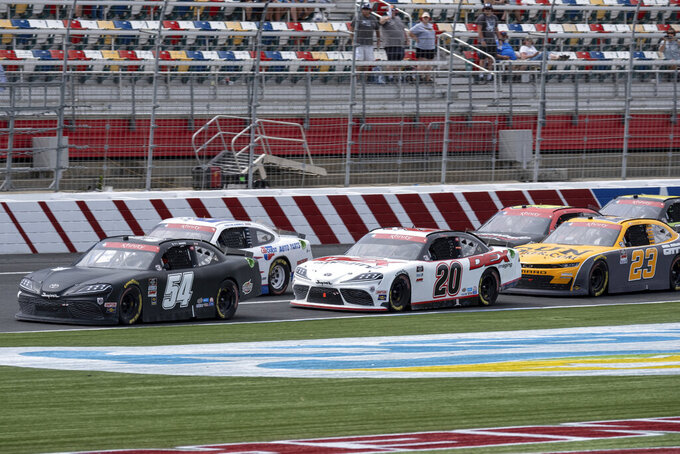 Ty Gibbs leads a restart during the Alsco Uniforms 300 NASCAR Xfinity Series auto race at Charlotte Motor Speedway on Saturday, May 29, 2021 in Charlotte, NC. (AP Photo/Ben Gray)