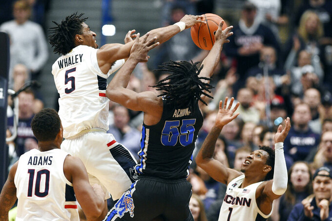 Connecticut's Isaiah Whaley (5) blocks a shot attempt by Memphis' Precious Achiuwa (55) during the second half of an NCAA college basketball game Sunday, Feb. 16, 2020, in Hartford, Conn. (AP Photo/Jessica Hill)