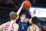 San Diego guard Finn Sullivan (5) looks to pass between Stanford defenders James Keefe (22) and Tyrell Terry (3) during the first half of an NCAA college basketball game on Saturday, Dec. 21, 2019, in San Francisco. (AP Photo/D. Ross Cameron)