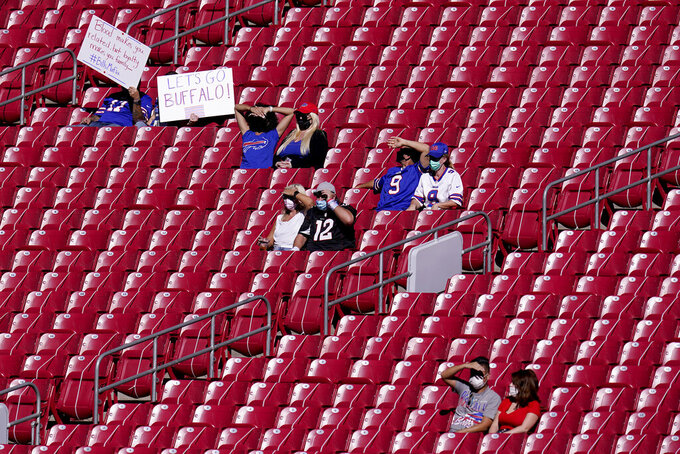 Fans arrive prior to an NFL football game between the Buffalo Bills and the Arizona Cardinals, Sunday, Nov. 15, 2020, in Glendale, Ariz. (AP Photo/Ross D. Franklin)