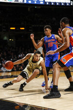 Vanderbilt forward Dylan Disu (1) loses his balance as he's pressured by Florida guard Noah Locke (10) during an NCAA college basketball game Saturday, Feb. 1, 2020, in Nashville, Tenn. (Wade Payne/The Tennessean via AP)