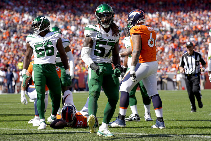 New York Jets middle linebacker C.J. Mosley (57) celebrates a defensive stop against the Denver Broncos during the first half of an NFL football game, Sunday, Sept. 26, 2021, in Denver. (AP Photo/David Zalubowski)