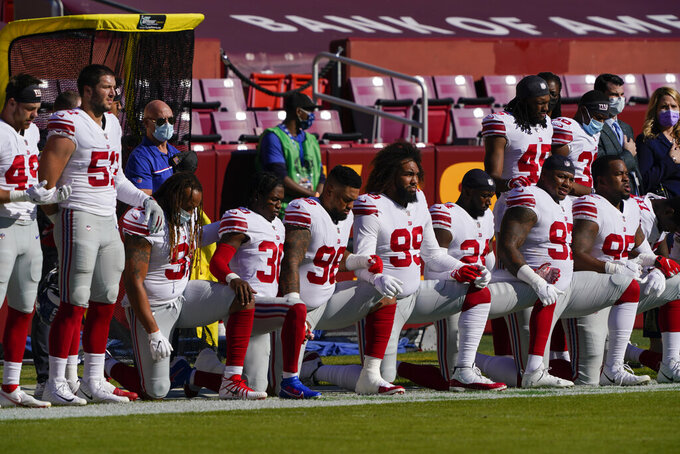 Members of the New York Giants before the start of the first half of an NFL football game against the Washington Football Team, Sunday, Nov. 8, 2020, in Landover, Md. (AP Photo/Susan Walsh)