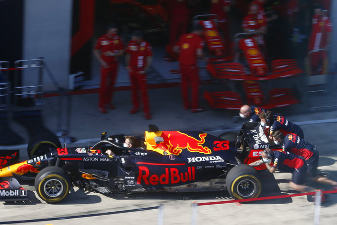 Mechanics push the car of Red Bull driver Max Verstappen as they practice tires change at the Red Bull Ring racetrack in Spielberg, Austria, Thursday, July 9, 2020. Styrian Formula One Grand Prix will be held on Sunday. (AP photo/Darko Bandic)