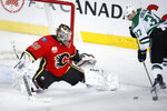 Dallas Stars' Justin Dowling, right, scores on Calgary Flames goalie Cam Talbot during the third period of an NHL hockey game Wednesday, Nov. 13, 2019, in Calgary, Alberta. (Jeff McIntosh/The Canadian Press via AP)