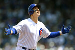 Chicago Cubs' Anthony Rizzo celebrates at third base after hitting a solo home run during the first inning of a baseball game against the Arizona Diamondbacks Sunday, July 25, 2021, in Chicago. (AP Photo/Paul Beaty)