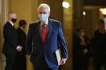 Senate Majority Leader Mitch McConnell of Ky., wears a face mask to protect against the spread of the new coronavirus as he walks to the Senate chamber after meeting with Vice President Mike Pence and Treasury Secretary Steve Mnuchin on Capitol Hill in Washington, Tuesday, May 19, 2020. (AP Photo/Patrick Semansky)