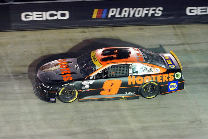 Chase Elliott drives through a turn during a NASCAR Cup Series auto race at Bristol Motor Speedway Saturday, Sept. 18, 2021, in Bristol, Tenn. (AP Photo/Mark Humphrey)